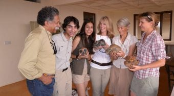 Pinto family looking at artifacts