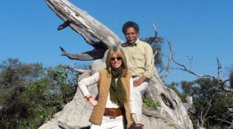 Joy and Dennis Pinto by tree stump