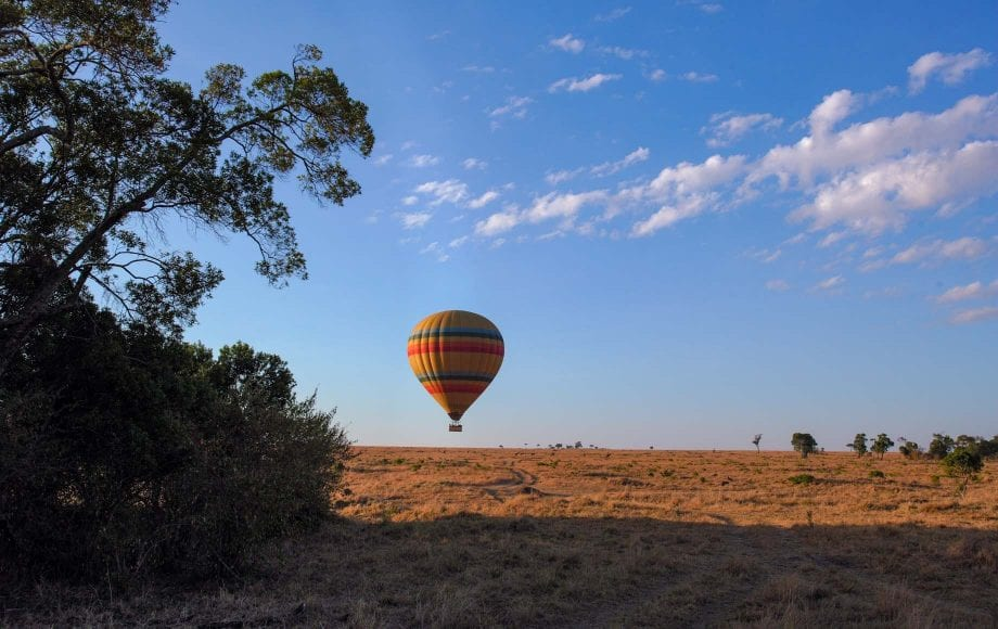 Hot air balloons floating over Africa