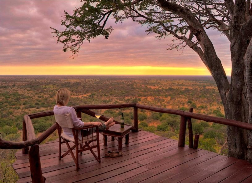 Enjoying champagne while watching sunset at Meru National Park, Kenya