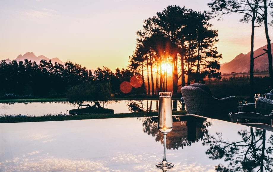 Champagne glass at the sunset of Cape Winelands