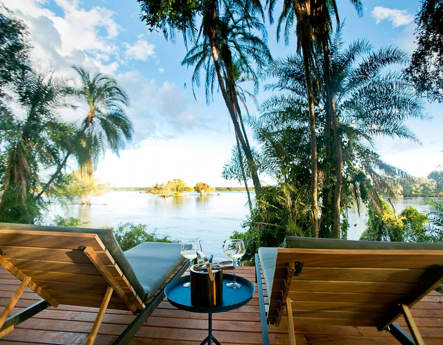 Chairs on deck overlooking river