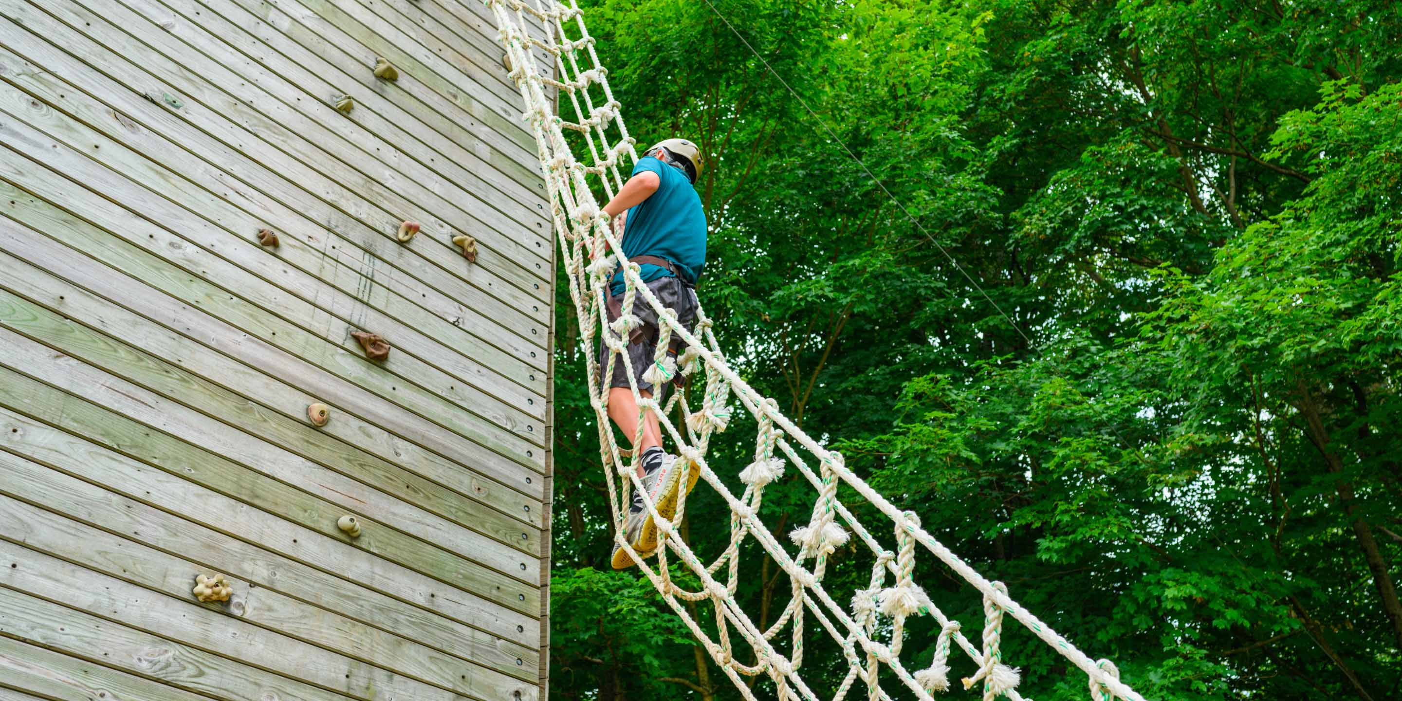 Camper going up ropes course