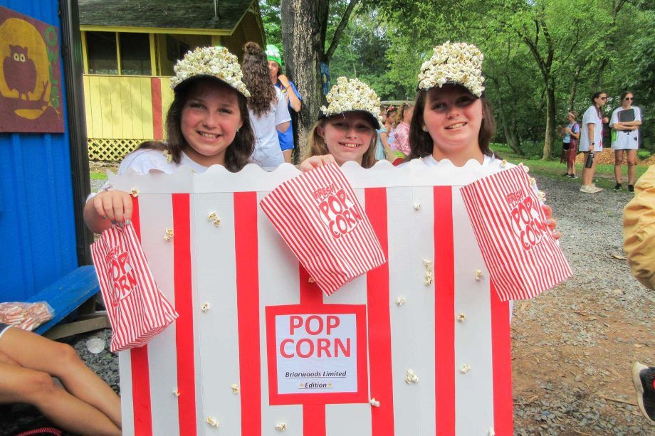 Three girls wearing a popcorn costume