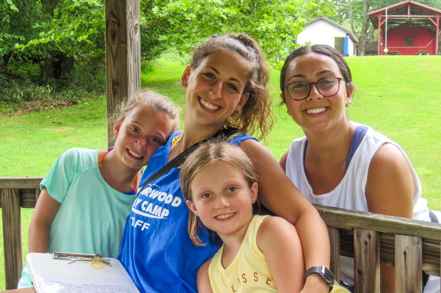 Female staff with campers smiling