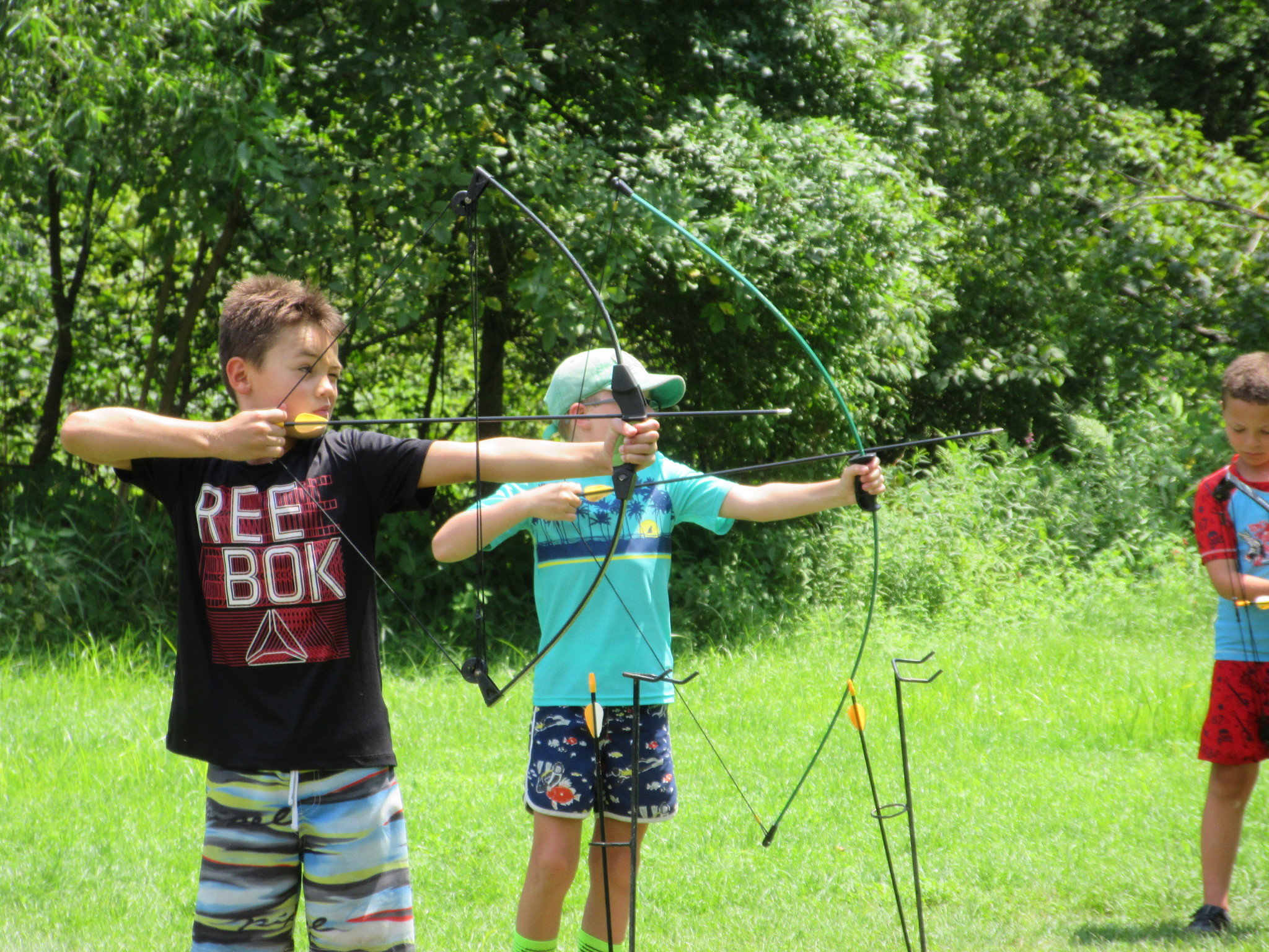 children practicing archery